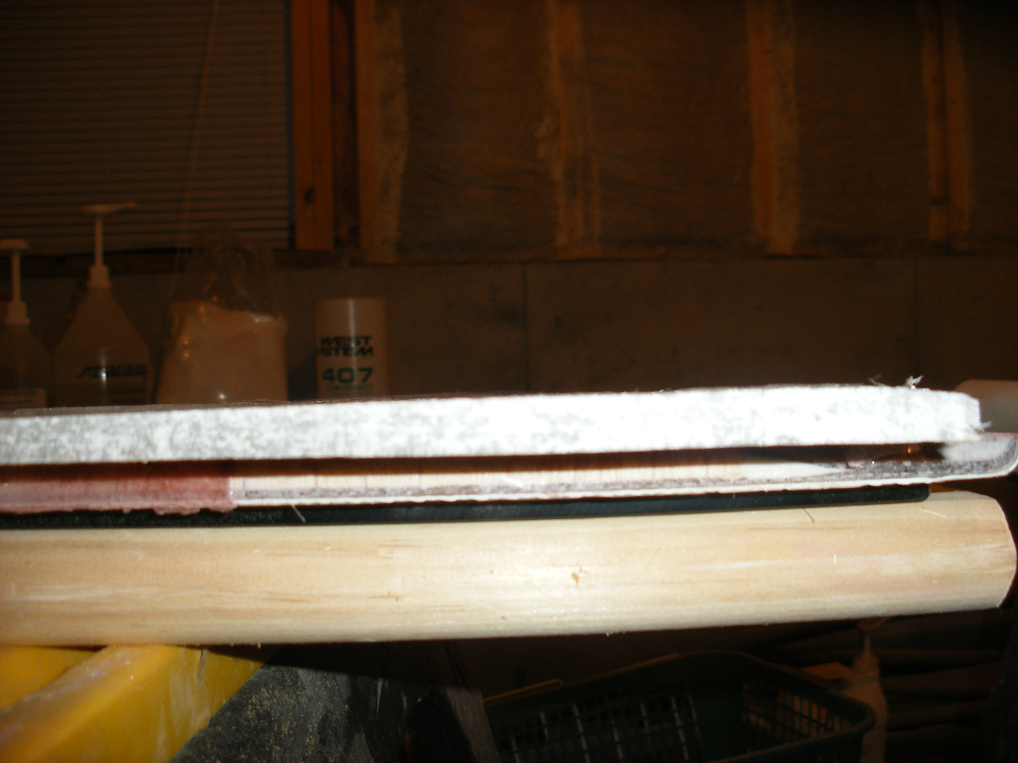 "1/2"" fiberglass bonded to the original lid.  Balsa wood core sealed with epoxy."