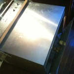 Lower access to oven broiler jet.  4 screws need to be removed to gain access.