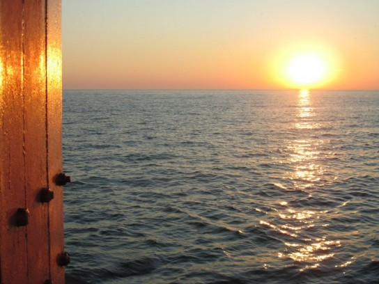 sunset relecting on pier