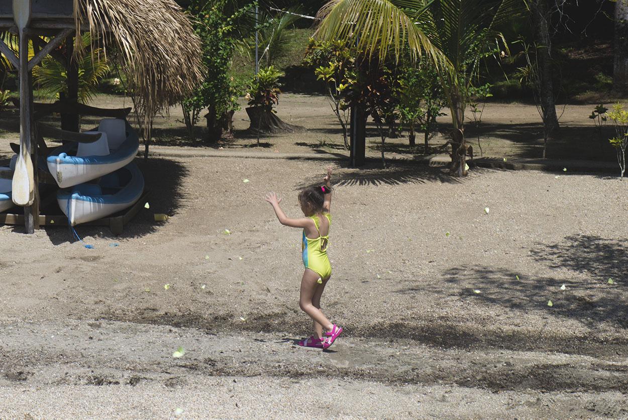 little girl running through butterflies