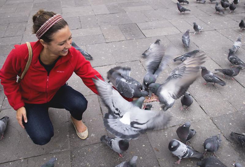 Jessica holding pigeons