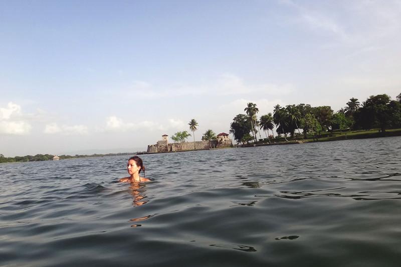 Jessica swimming in front of Castillo