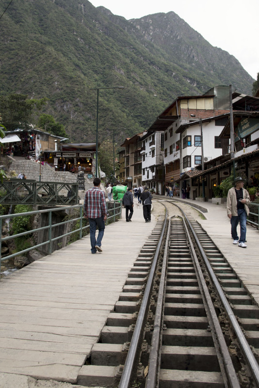 old train tracks running through Aguas Calientes