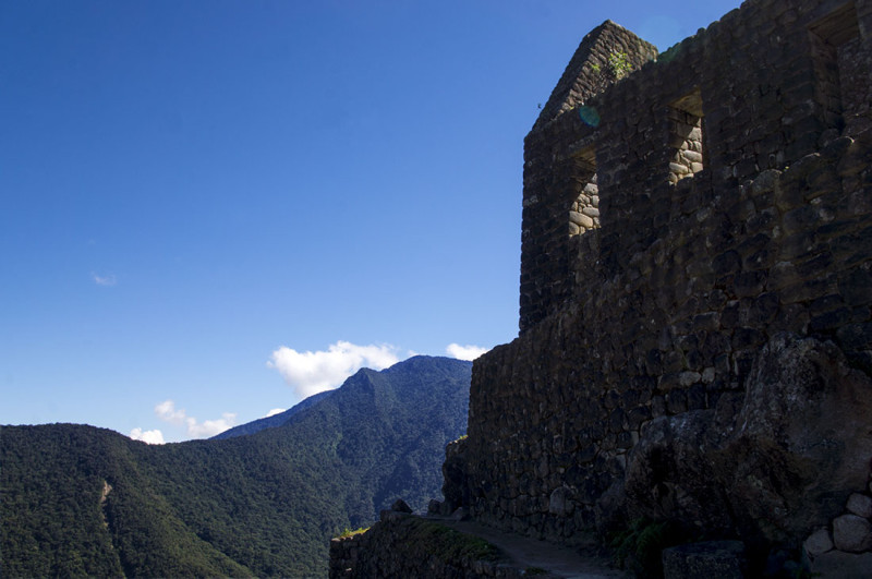 looking up at stone house on Huayna Picchu