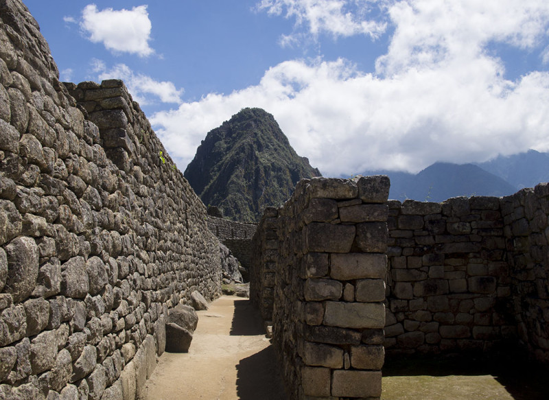 dirt path through stone walls  Machu Picchu