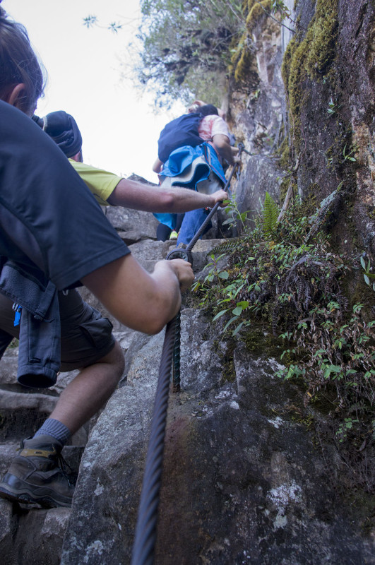 climbing the steep steps at Hauyna Picchu