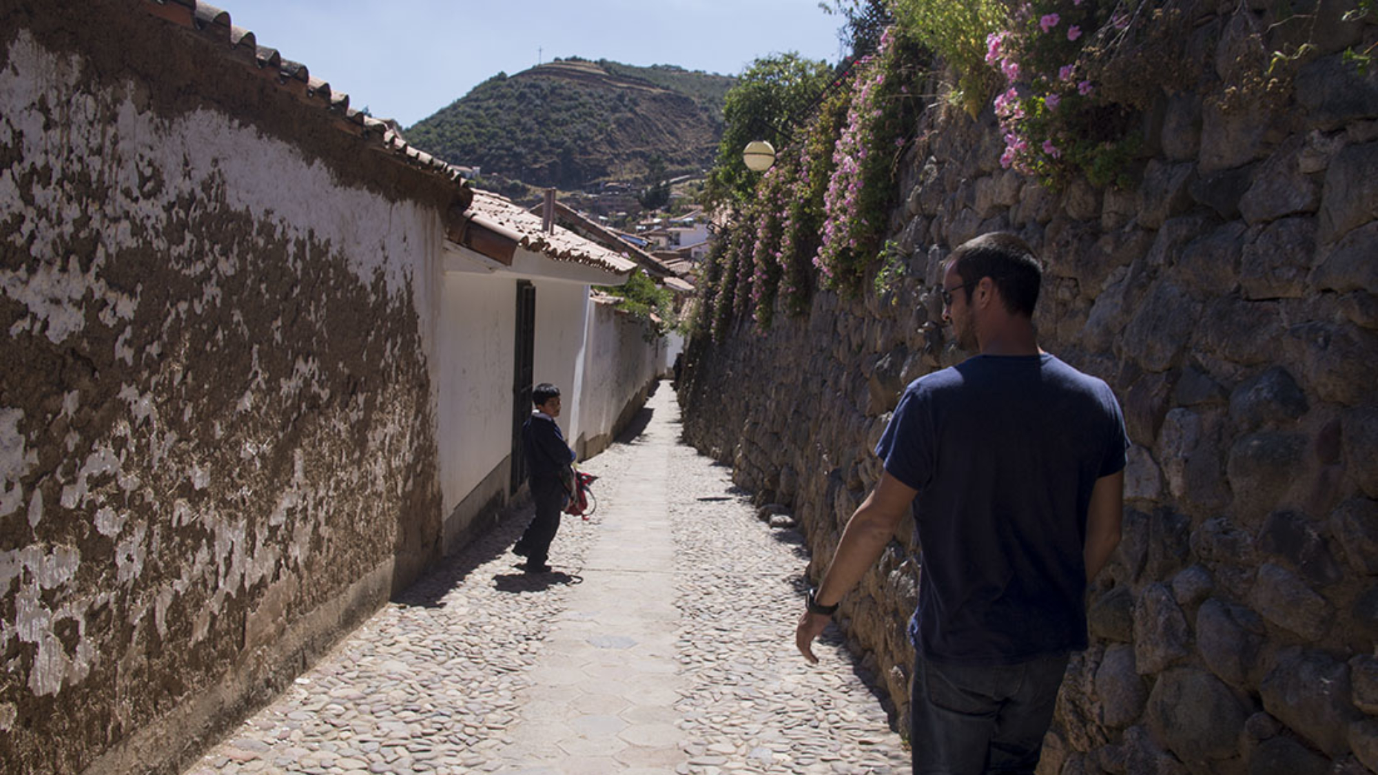 Matt walking down a back alley in Cusco