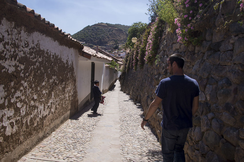 Matt walking down a back alley in Cusco