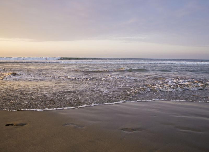 surfers at sunset, Mancora Peru