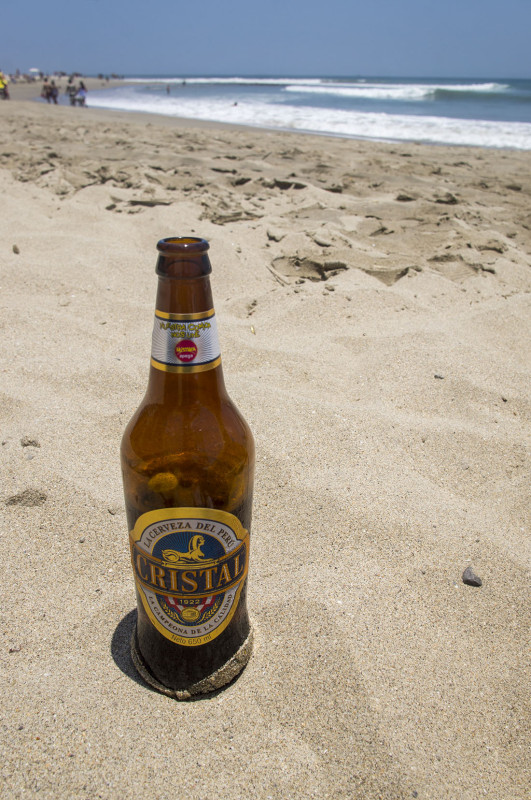 enjoying a Cristal beer on the beach in Mancora Peru