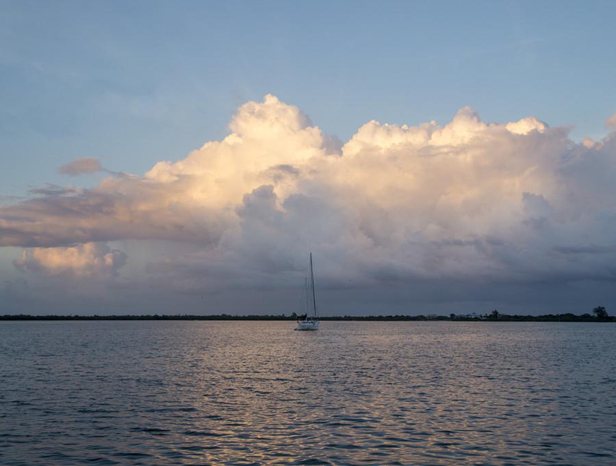 sunset over sailboat, Cay Caulker, Belize
