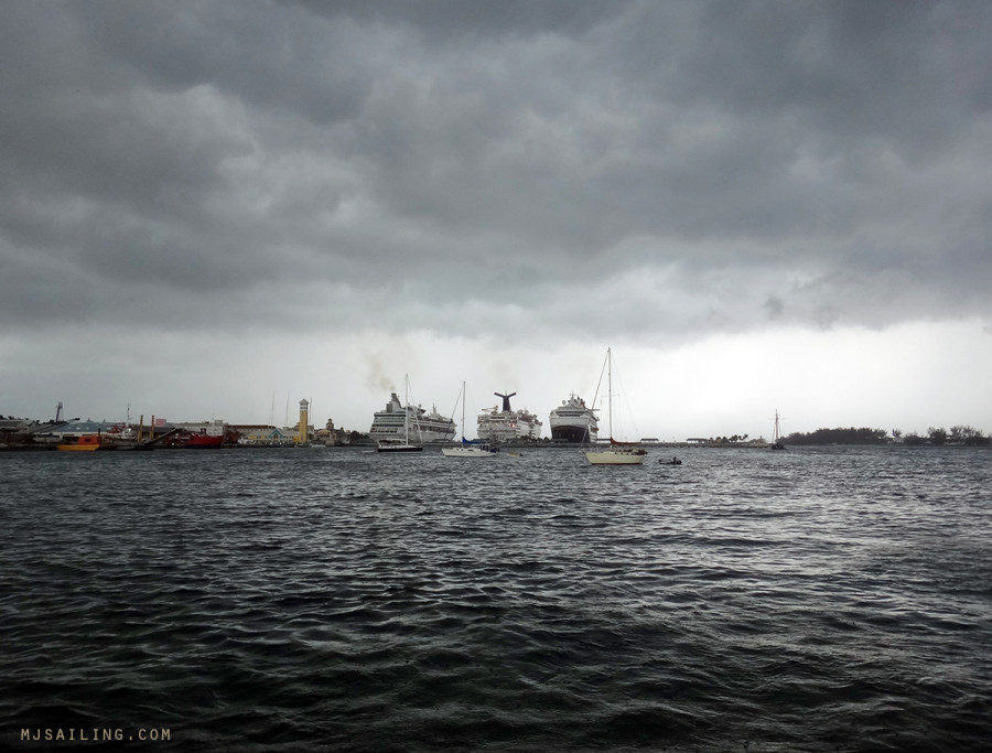 storm clouds over cruise ships