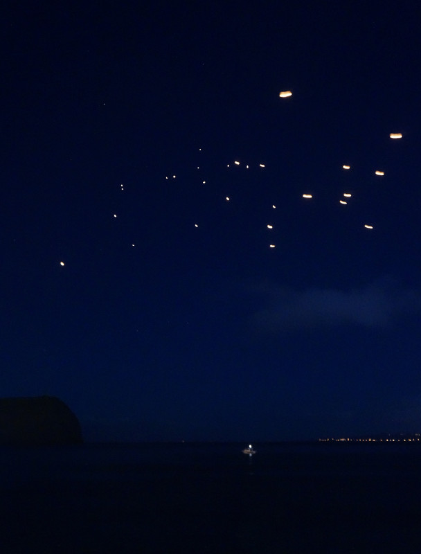 fire lanterns over Horta's harbor