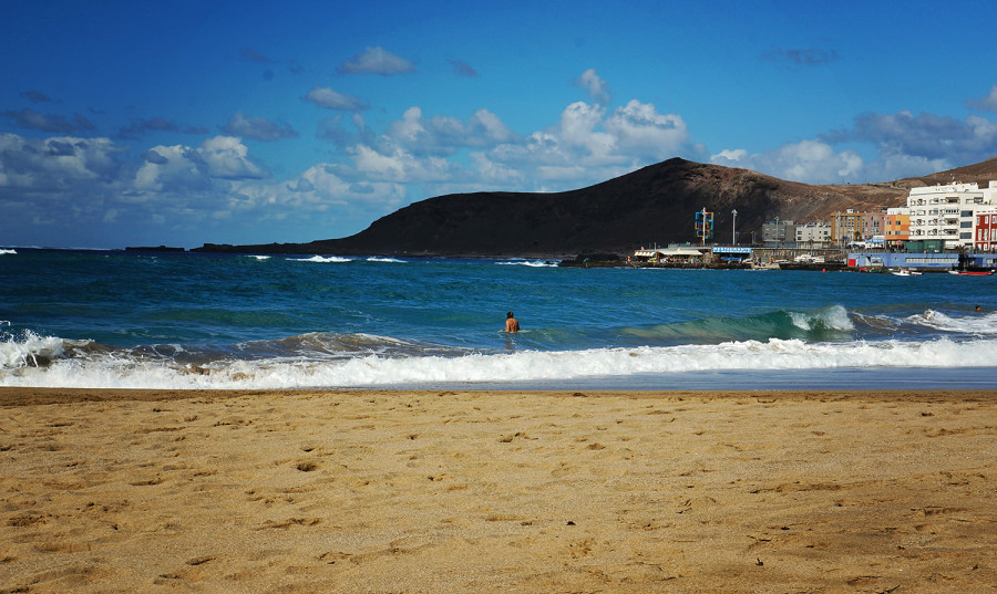 Alex surfing waves at Playa Canteras