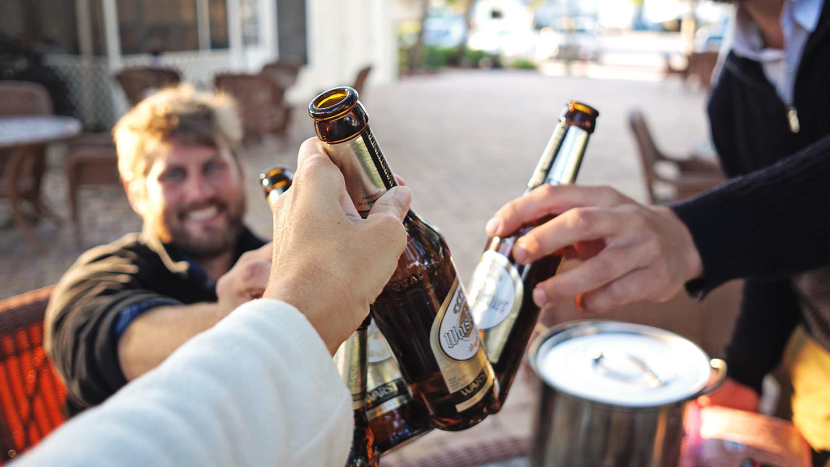 cheers with Warsteiner