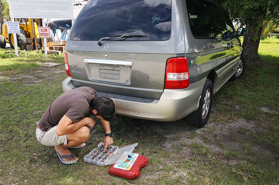 putting plates on our new vehicle
