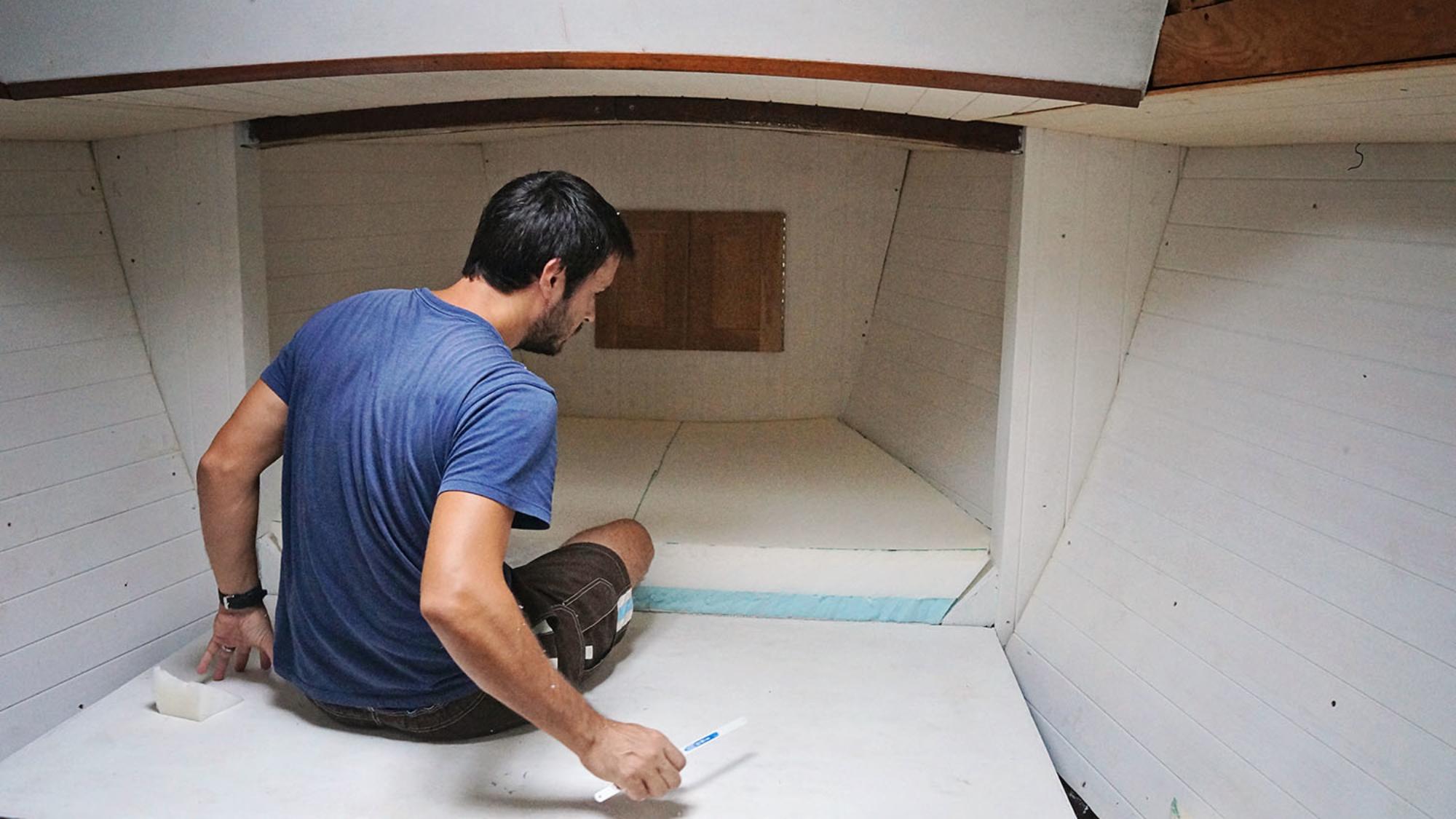 Matt installing v-berth foam