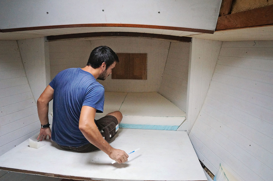 Matt installing v-berth foam