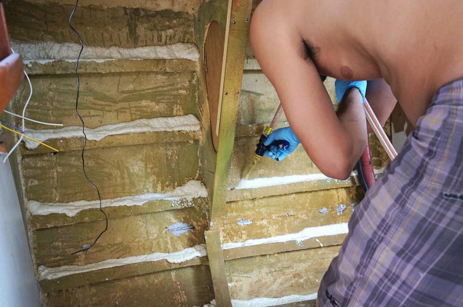 Matt installing spray foam