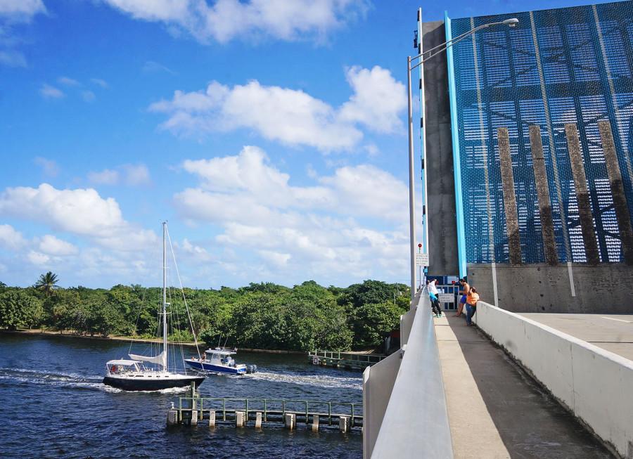 sail boats under draw bridge