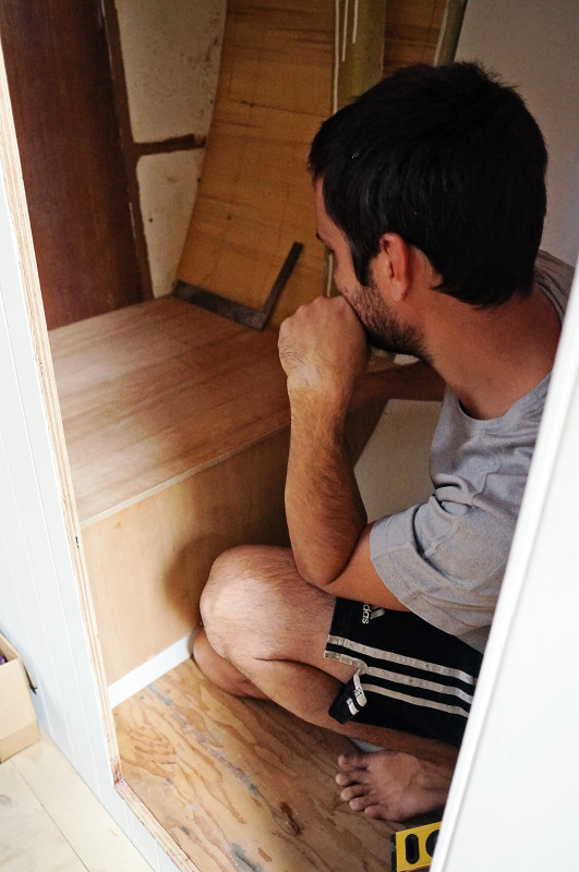 Matt building plywood box for toilet