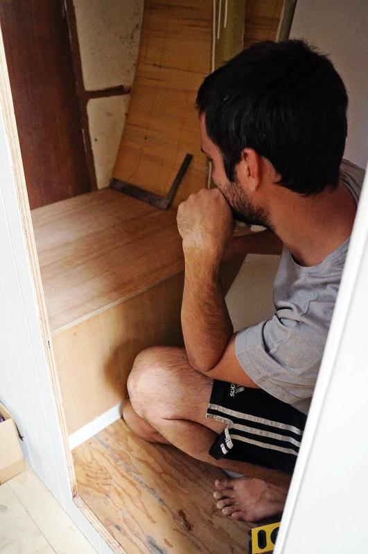Matt building plywood box for toilet