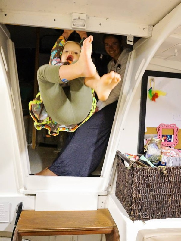 Ani swinging from companionway