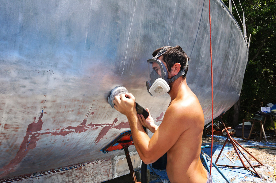 Matt sanding the hull